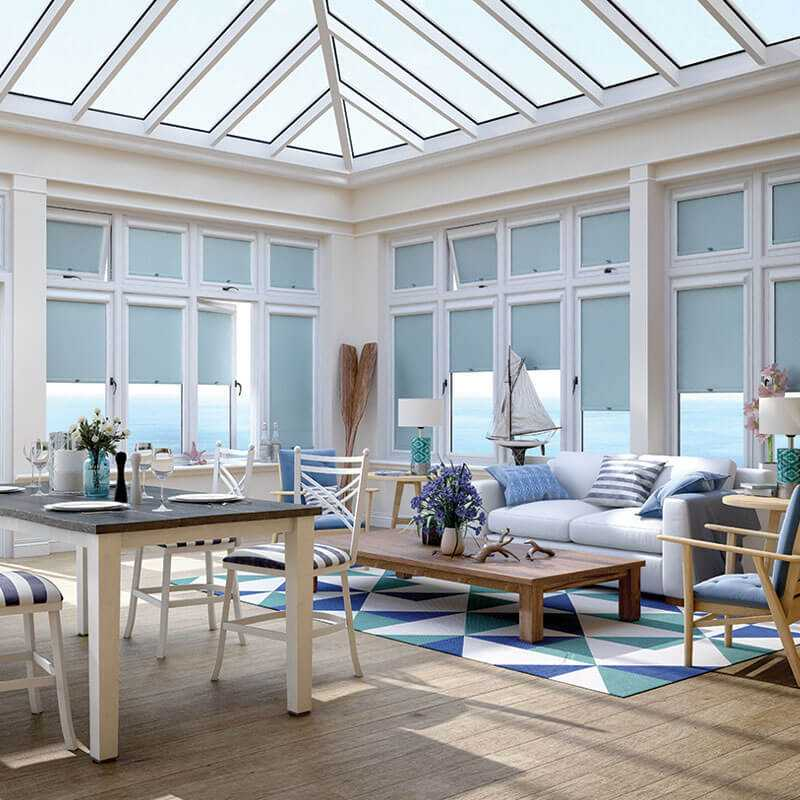 Light blue perfect fit roller blinds in conservatory